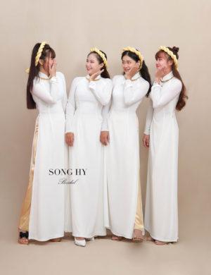 áo dài bưng quả trắng thiết kế 4 tà kết viền đồng 1